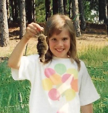 Becky Johannes holding a rodent in 1991